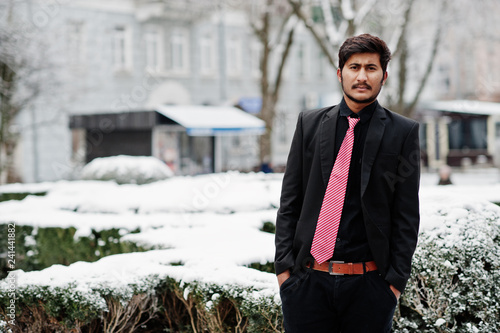 Fotografie, Obraz  Young indian man on suit and tie posed outdoor in winter day.