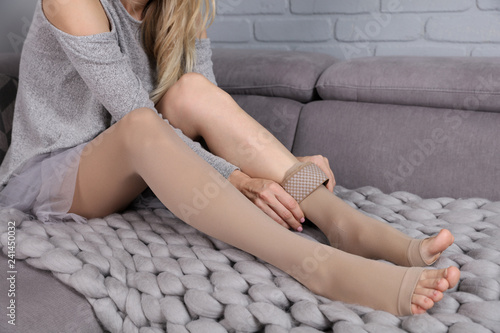 Fototapeta Varicose veins prevention, Compression tights, relief for tired legs