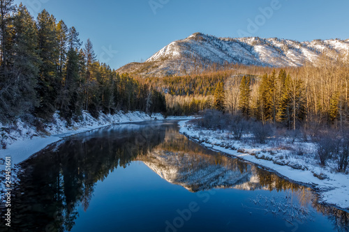 Fotografia, Obraz  Peaceful calm sunny day at McDonald Creek, Glacier National Park, Montana in Dec