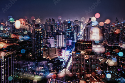 Fotobehang - Cityscape in the night with blur of city light and zoom in lens camera