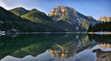 Morning Sun Lights On Mountains Above Lago Del Predil In The Julian Alps, In Slovenia. Calm Water And Beautiful Reflections