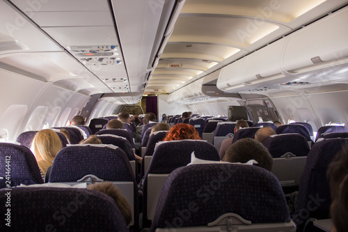 Tuinposter interior of a plane with people