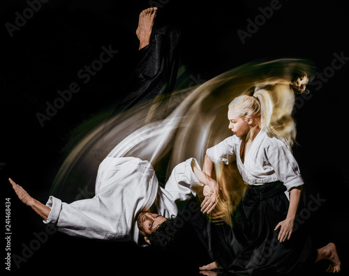 Canvas Print two bodokas fighters man and woman practicing Aikido studio shot isolated on bla