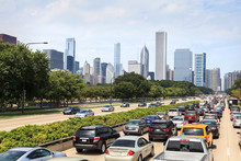 Cars Driving On Lake Shore Drive With Downtown Chicago Shown In The Background