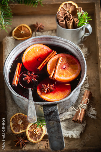 Tasty and homemade mulled red wine on rustic table