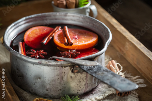 Tasty and homemade mulled red wine with spices and spruce