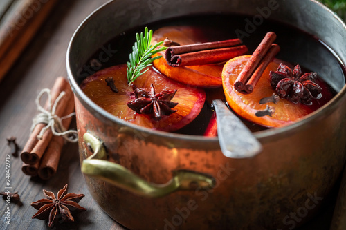 Tasty and homemade mulled red wine with cinnamon and oranges