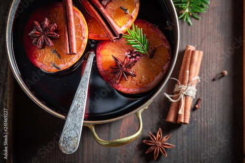 Sweet and delicious mulled red wine with spices and spruce
