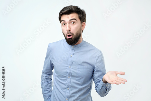 Spanish angry and discontented man spreading his hand and ask what do you mean Wallpaper Mural