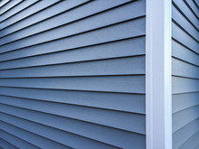 Blue Vinyl Siding With White T...