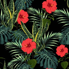 Fototapeta Do sypialni Seamless exotic pattern with tropical leaves and exotic plant, red hibiscus flowers on a black background.
