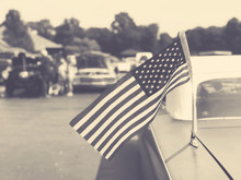 Vintage American Flag On Old Classic Car At Cruise In Car Show, Sepia Retro Style