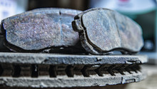 Old Brake Pads On The Brake Disc With A Shallow Depth Of Field