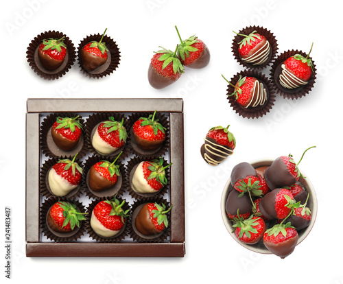 Set with chocolate covered strawberries on white background, top view