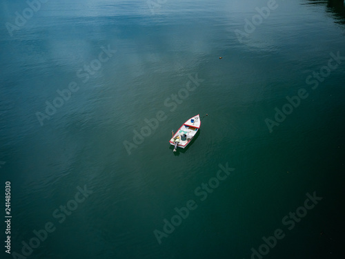 Aerial Drone image of a colorful rowboat just offshore on a Costa Rica Beach