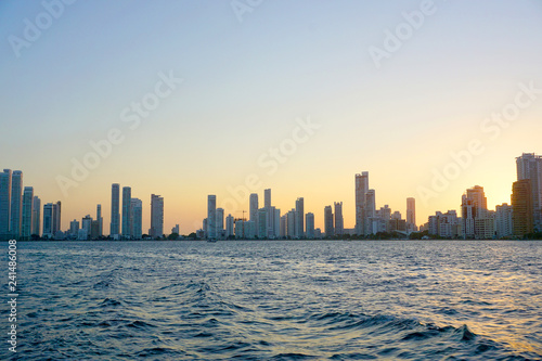 Foto op Plexiglas Chicago Cartagena / Colombia - 12 25 2018: Panoramic view of the coastline of the city and the sea with blue sky with some boats or ships with a sunset and buildings