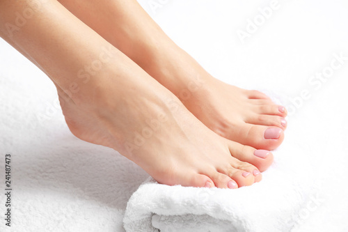 Foto op Canvas Pedicure Woman with smooth feet on white towel, closeup. Spa treatment
