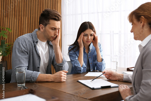 Fotografie, Obraz  Lawyer having meeting with young couple in office