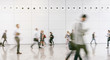 large crowd of anonymous blurred people walking in a modern hall