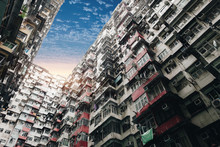 Looking Up At Old Building To Sky In Perspective View At Sunset, HongKong. Old Tall And Dense Residential Building In Hong Kong At Dusk.