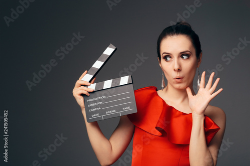 Elegant Actress in Red Dress Holding Cinema Clapboard Canvas Print