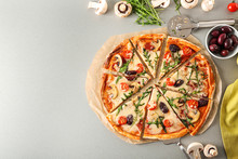 Delicious Pizza And Ingredients On Table