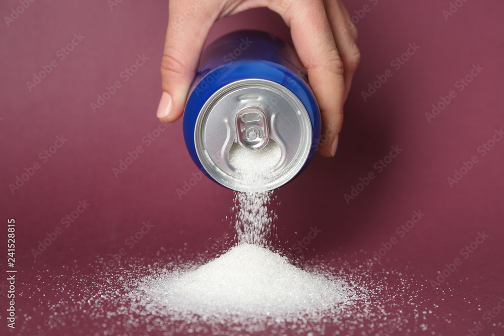 Fototapety, obrazy: Woman pouring sugar from can on color background