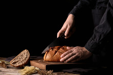 Woman Cutting Fresh Bread On T...