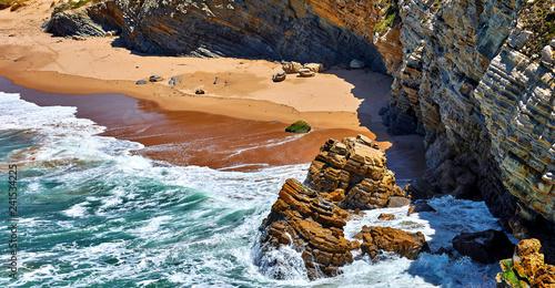 Fotografie, Tablou  Surf at coast of Atlantic Ocean in Portugal. Beach with golden