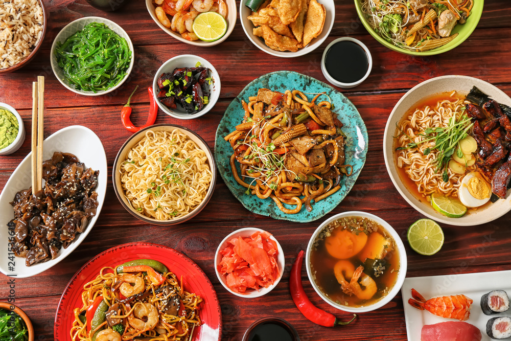 Fototapety, obrazy: Assortment of Chinese food on wooden table