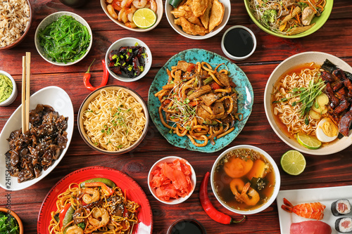 Assortment of Chinese food on wooden table Canvas Print
