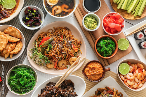 Photo  Assortment of Chinese food on white table