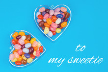 Two Hearts With Candies On Blu...