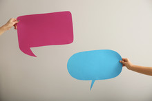 Female Hands With Blank Speech Bubbles On Light Background