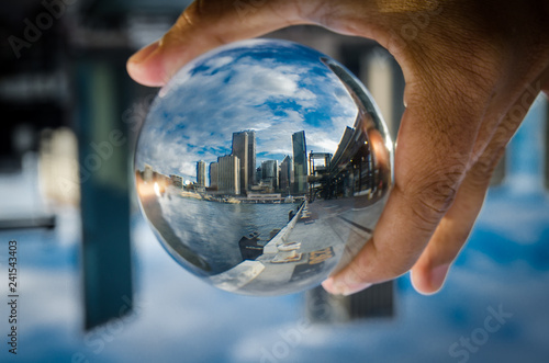 Canvastavla  Cityscape photography in a clear glass crystal ball with dramatic clouds sky