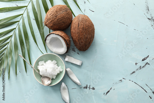 Composition with coconut oil on color background Fototapeta