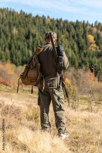 Hunter on hunting in the mountains, forestland
