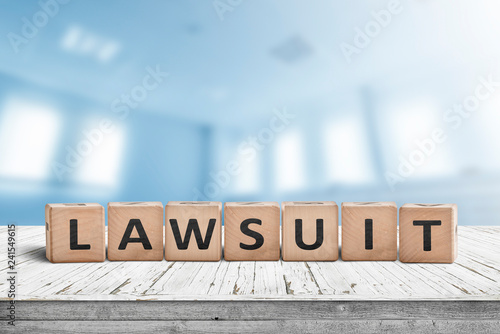 Photo  Lawsuit sign on a wooden table