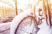 Bike Under Snow Parked Along The Street In Paris
