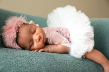 Portrait Of Cute African-American Baby Sleeping In Soft Armchair