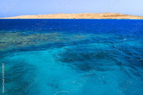 Fotobehang Turkoois blue water texture from hot Egypt