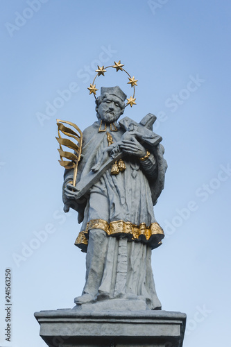 фотография Statue of Saint John of Nepomuk in Olesno, Poland with gold elements: palm of martyrdom, halo of five stars, robes and crucifix cross with Jesus