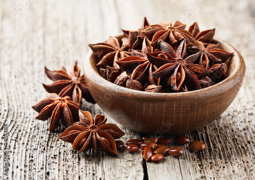 Anise star on wooden board