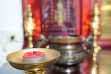 A Candle With Incense Burner. ...