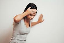 Woman Suffering From Dizziness...