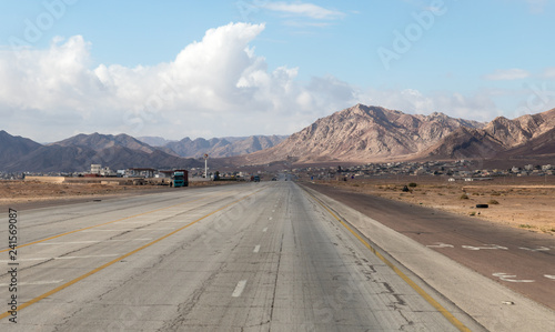 Photo Stands Eggplant Intercity route passing near the foot of the Red Mountains in the south of Jordan, not far from Maan city