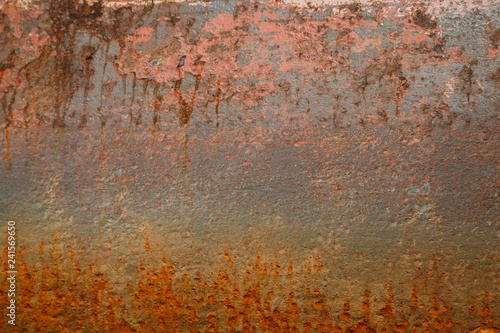 Poster Metal Rusty surface of the hull of a ship standing in a dry dock during repairs as a background