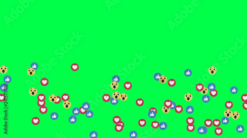 фотографія  Like, thumb up, blue icons, wow reaction icon, and hearts on Facebook live video isolated on green background
