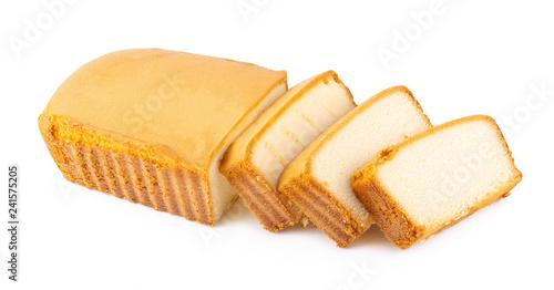 Slika na platnu Sliced moist butter cake isolated on white background.
