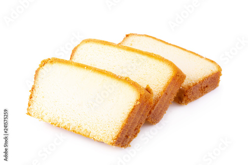 Tablou Canvas Sliced moist butter cake isolated on white background.